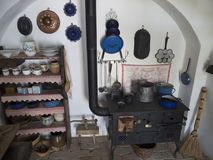Country home vintage pots and pans. Displayed shelf. Black iron furnace. Retro farm home Royalty Free Stock Photos