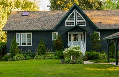 Country home with wooden siding Royalty Free Stock Images