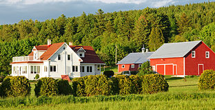 Country Homestead. Immaculate farm buildings in rural Quebedc Royalty Free Stock Photos