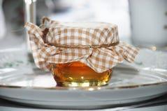 Country honey jar. Sweet plaid wrapped country honey jar Stock Photo