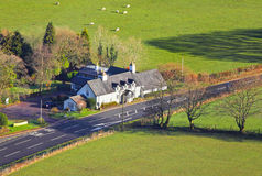 Country hotel or guest house building. Generic aerial rural country hotel or guest house building surrounded by countryside Stock Photos
