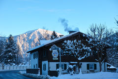 Country hotel in snowy mountain landscape Royalty Free Stock Photography