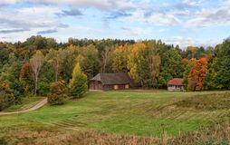 Country house autumn landscape Rumsiskes Lithuania. Autumn scene of etnographic country house in Rumsiskes Etnographic museum, Lithuania Stock Image