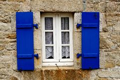 Country house with blue shutters in Brittany. Typical country house with blue shutters in Brittany, France Stock Images