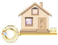 Country house of bricks with a golden key in a gift Wooden house with the main entrance doors and windows Royalty Free Stock Images