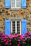 Country house in Brittany. Fragment of a typical country house with blue shutters in Brittany, France Royalty Free Stock Photos