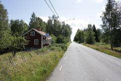 Country house. A cozy red cottage in the country side. Photo taken in Bergslagen in Sweden Stock Photography