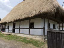 Country house from Eastern Europe with straw roof Stock Photos