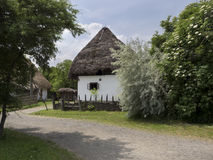 Country house from Eastern Europe with straw roof Royalty Free Stock Photo