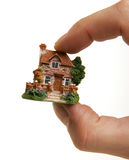 A country house between fingers Royalty Free Stock Images