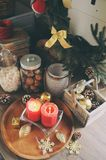 Country house kitchen decorated for Christmas and new year Holidays. Marhmallows, candles, cocoa and nuts in modern jars Stock Photos