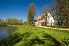 Country house at the lake Stock Images