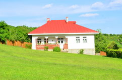 Country house and lawn Stock Photos