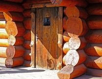 Country house made of natural logs. Oak door. stock image