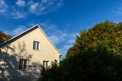 Country house with oak trees. In green summertime stock images