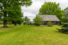 Country house with oak trees. In green summertime stock photo