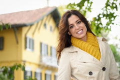 Country house owner tranquility. Confidence female home owner standing in front of her country house smiling Royalty Free Stock Image