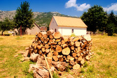 Country house with pile of firewood Stock Photo