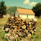 Country house with pile of firewood Royalty Free Stock Images
