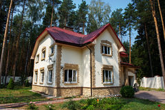 Country house in a pine forest Royalty Free Stock Image