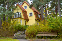 Country house in the pine wood Royalty Free Stock Image