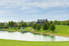 Country house and pond. On sunny summer day Stock Images