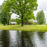Country house with pond and oak trees with pond Stock Image