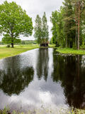 Country house with pond and oak trees with pond Royalty Free Stock Images