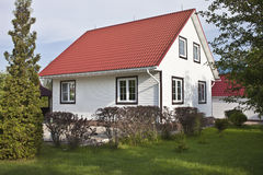 Country house with red roof and garden Stock Photography