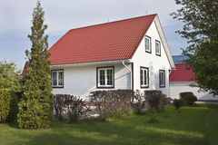Country house with red roof and garden Stock Image