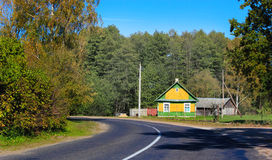Country house by the road and surrounded by greenery. Royalty Free Stock Photo