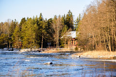 Country house of Russian Tsar Alexander III, Finland, Kotka, Langinkoski. Spring landscape with river and forest Royalty Free Stock Image