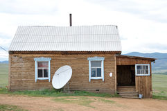 Country house with satellite dish. In front royalty free stock images