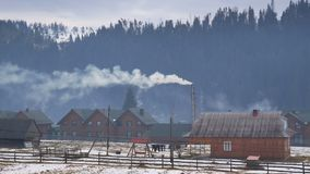 Country house smoke snow. Country house with smoke from chimney, snow covered stock footage