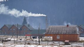 Country house smoke snow stock footage