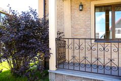 Country house with stone steps. And wrought iron railings royalty free stock photography