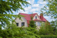 Country house surrounded by green trees on a summer day royalty free stock photo