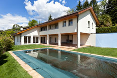 Country house with swimming pool Stock Images