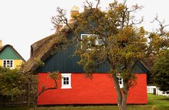 Country house with thatched roof_2. Lovely country house with an old garden in Denmark royalty free stock image