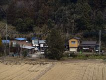 Country house by train in Japan. Tokyo, Jepen, January 20 2019 Blurred Transporting a country house by train in Japan Looking outside a train window at Japan stock photography