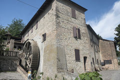 Country house with watermill near Castell`Arquato. Country landscape at summer along the road from Fiorenzuola d`Arda to Castell`Arquato Piacenza, Emilia-Romagna Stock Photo