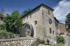 Country house with watermill near Castell`Arquato. Country landscape at summer along the road from Fiorenzuola d`Arda to Castell`Arquato Piacenza, Emilia-Romagna Royalty Free Stock Image