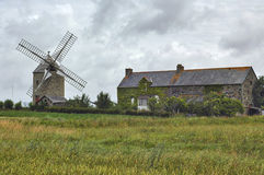Country house and windmill in Normandy Stock Photography