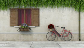 Country house with window and bicycle Stock Photography