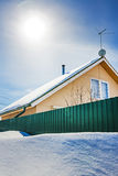 Country house in winter in the snow Royalty Free Stock Photo