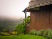 Country house. Wooden house in early morning with fog - Gramado city - Brazil Royalty Free Stock Image