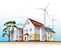 Country houses, alternative energy. Individual residential houses. Suburban homes or cottages. Wind power plant Stock Photography