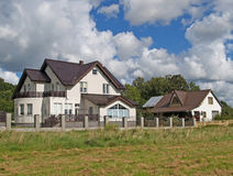 Country houses with brown tile roofs. Kaliningrad region Stock Photos