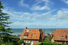 Country houses with sea view in the region of Normandy, France on a bright sunny day. Beautiful countryside, lifestyle Royalty Free Stock Image