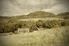 Country idyll with old farmhouse. And hill stock photos